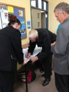 John Sturgeon former All Black manager and Mayor of Greymouth Tony Kockshorn signing the White Ribbon banner in Greymouth.