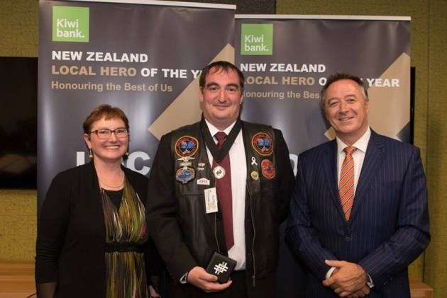 Neil with the CEO OF Kiwi Bank getting his medal