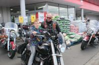 Ken with a young fella on his bike at the Warehouse Invercargill