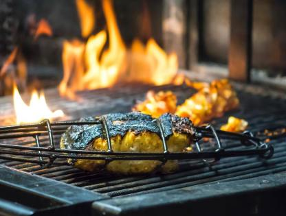 Vegetables cooked on charcoal grill at Rovi