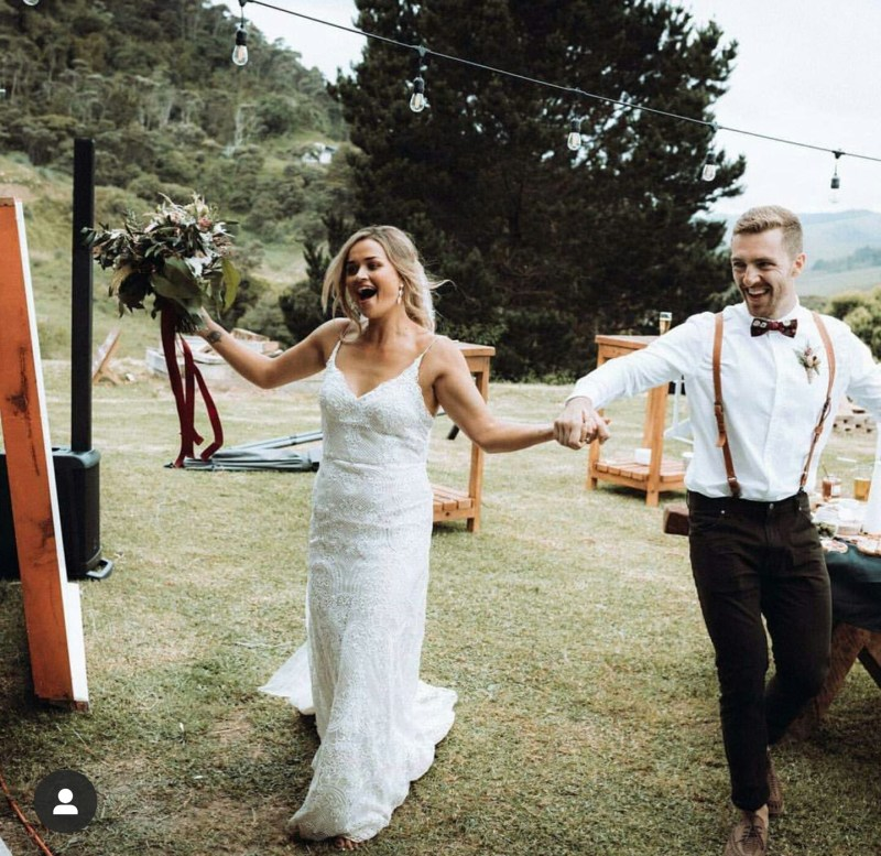 A bride and groom celebrate their recent marriage