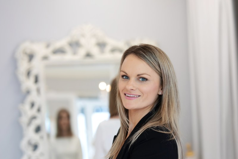 White Silk Bridal Couture designer Nicky Hayward smiles in her boutique