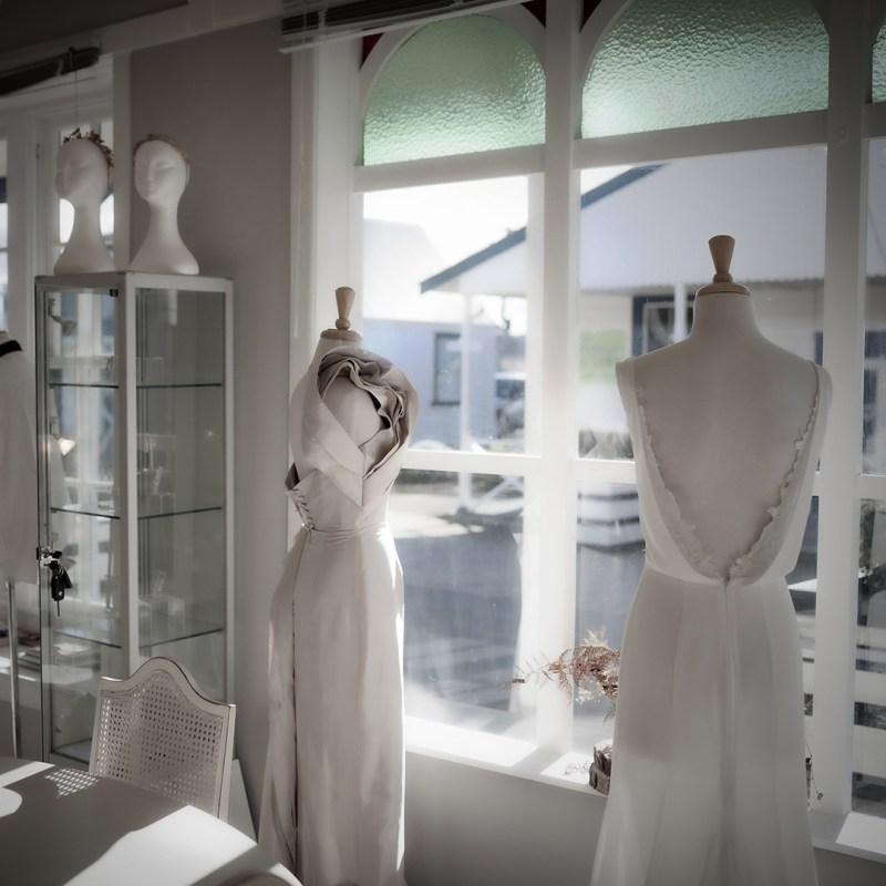 Two bridal gowns on mannequins in the White Silk Bridal Couture shop in Tauranga
