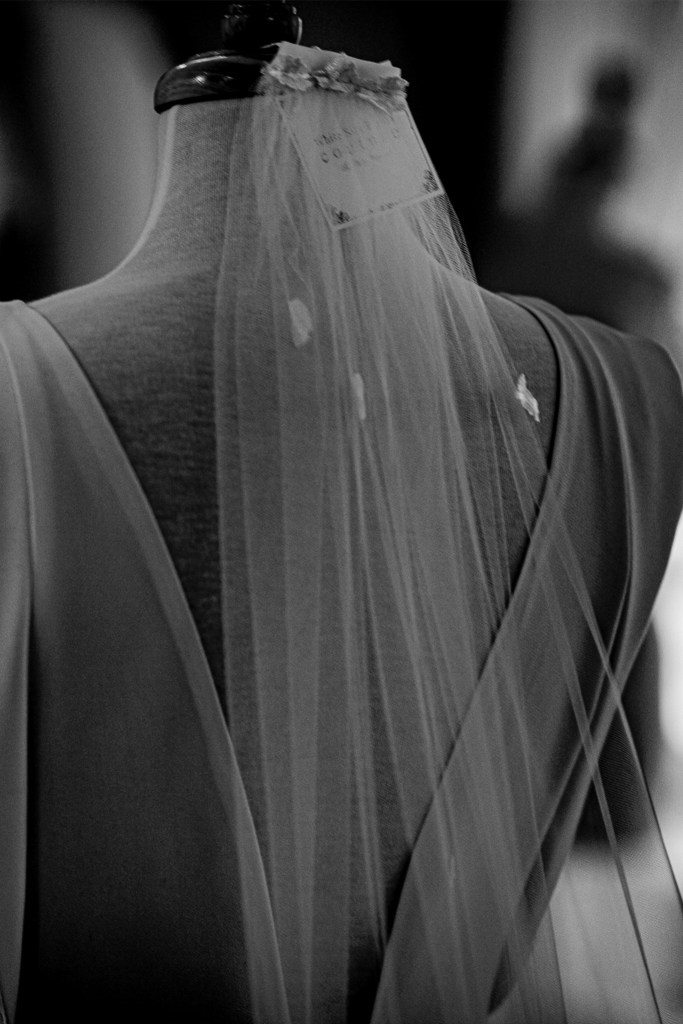 A close up of a bridal gown veil