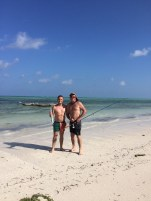 Colton and his Dad coming in from fishing - Paje, Zanzibar