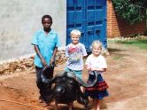 Colton, his sister and friend with a Buffalo head - Africa 1990's