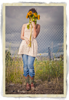 Girl covering mouth with flowers