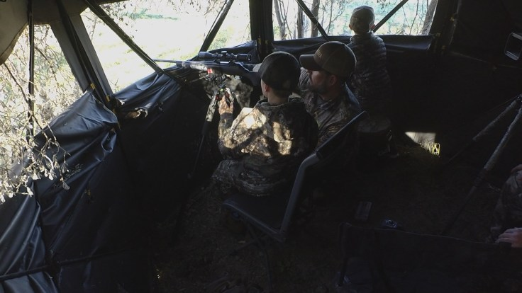 Landon (left) gets insturciton for his father Steve while Callen keeps an eye out for deer.