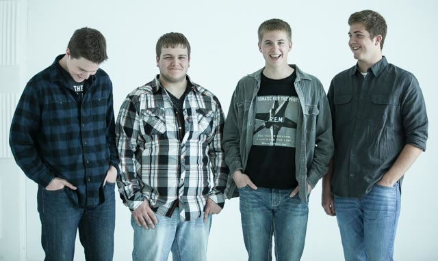 4 members of Brookings, SD based rock band Horseplay pose at The White Wall Sessions