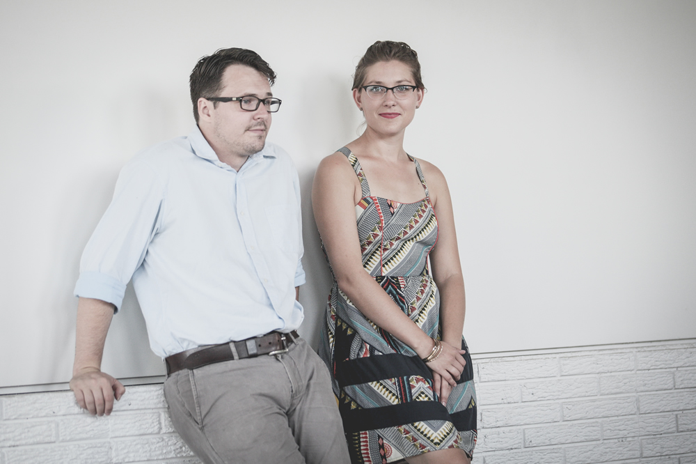 Adrian & Meredith pose in the White Wall studio in Sioux Falls
