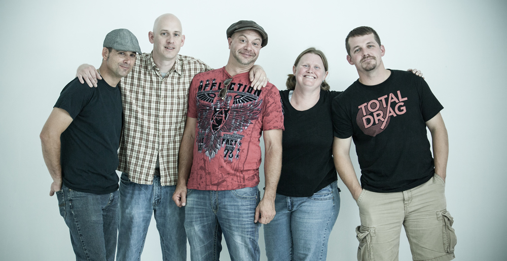 5 members of Sioux Falls ska/punk group, Donnybrook Brawlers, smile for the camera at The White Wall Sessions