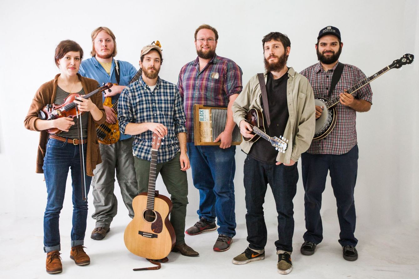 Duluth's Black River Revue pose with their instruments
