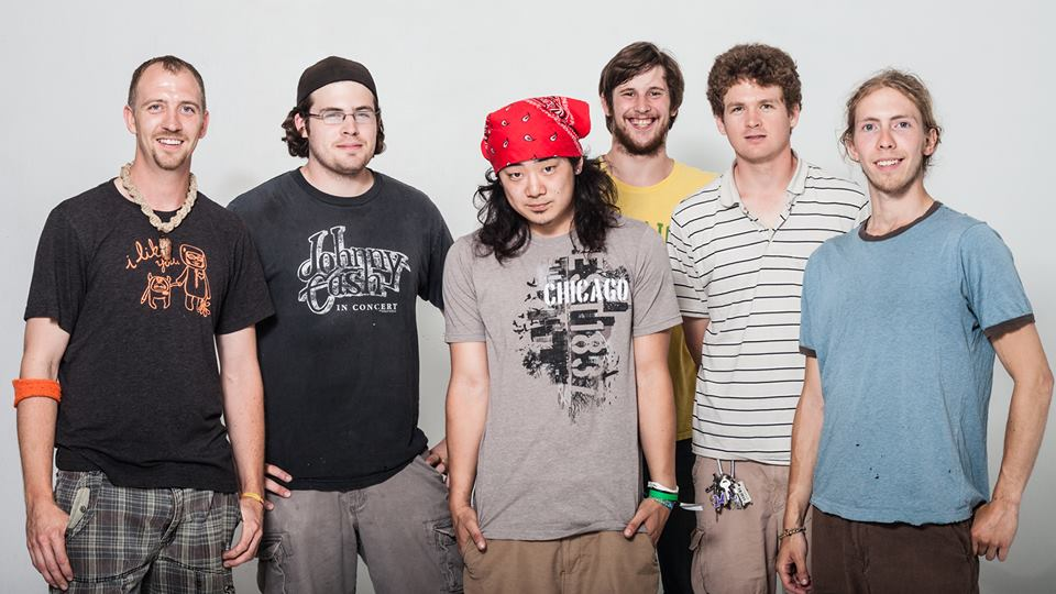 6 members of Minneapolis' bluegrass/jam band, Kind Country, pose at the White Wall studio in Sioux Falls
