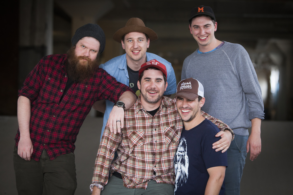 5 members of Minneapolis' folk group, Thirsty River, pose outside the White Wall studio in Sioux Falls