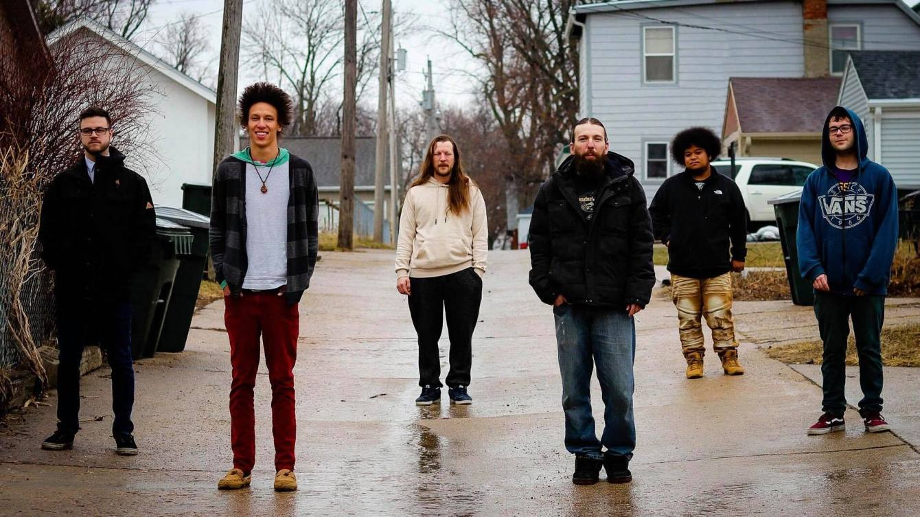 6 members of Vibe Rations from Sioux City stand spaced out in a drive way.