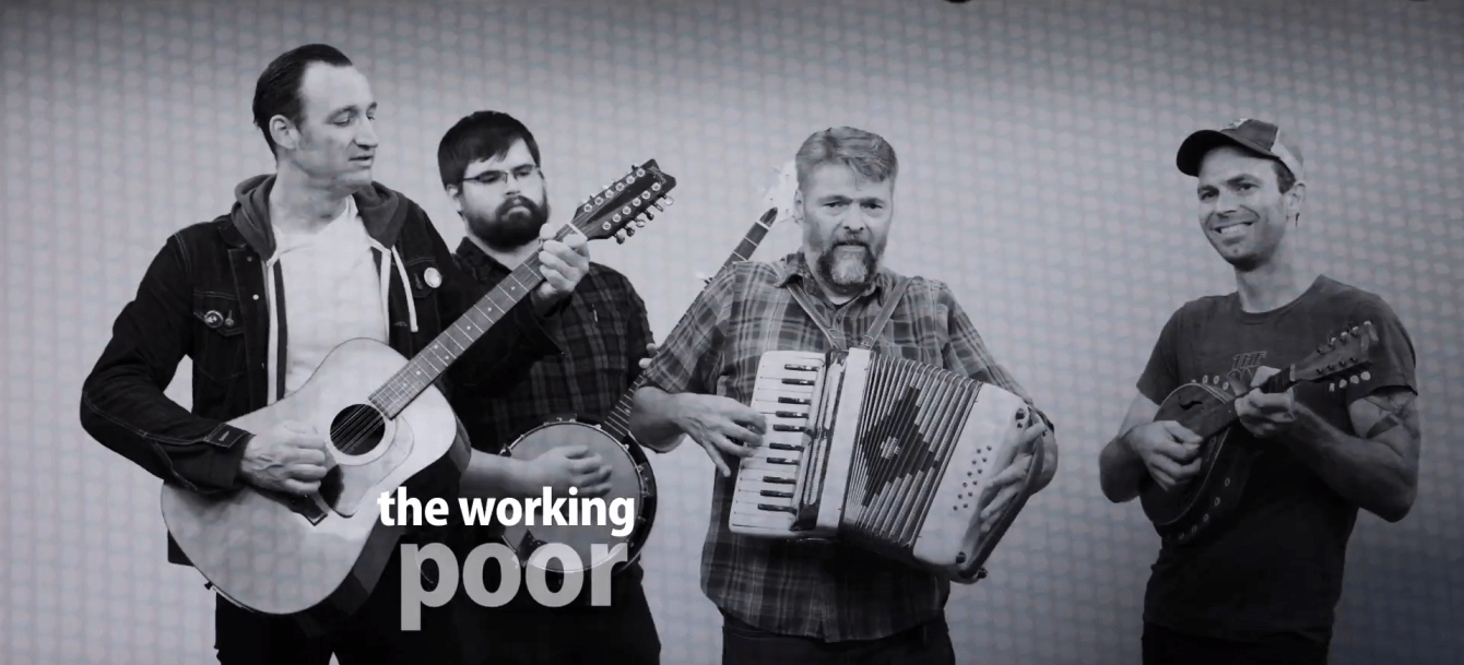 Sioux Falls super group, The Working Poor, hold their instruments and pose for a picture