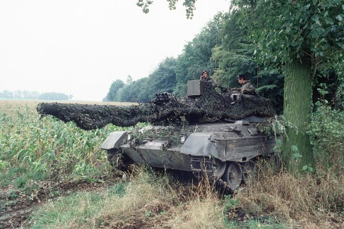 West German soldiers aboard a camouflaged Leopard I main battle tank during Exercise REFORGER '83.