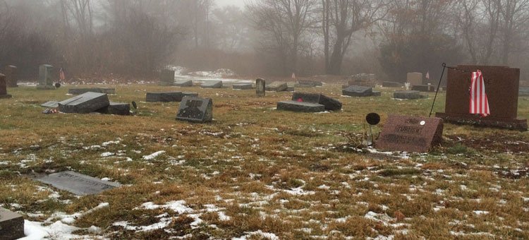 Whitman Police are seeking the public's assistance as they investigate the vandalism of 67 gravestones at Colebrook Cemetery. The damage was discovered and reported by a citizen Sunday morning. Photo by Stephanie Spyropoulos