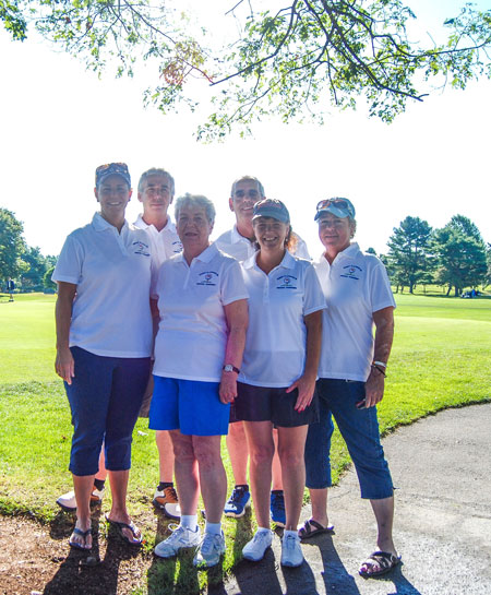 Billy and Bobby Leonard,back row, and  (front at left) sister Donna Leonard, mother Gerry Leonard and sisters Nancy McGee and Patty Fullerton pose for a family photo during the Leonard Family Golf Tournament.                     Photo by Stephanie Spyropoulos.