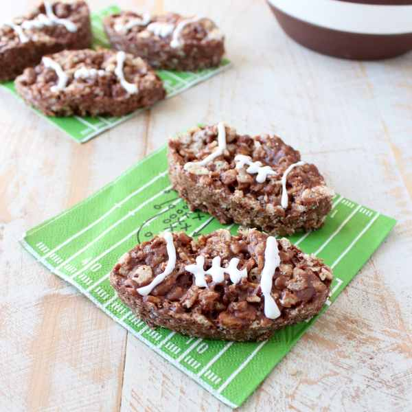 Nutella Rice Krispie Treats are a deliciously easy dessert, make them football shaped for game day parties or Superbowl Sunday!