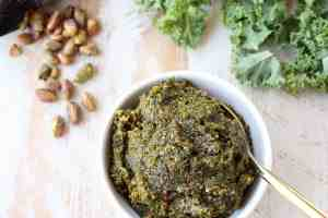 Fresh kale, pistachios and coconut oil are combined in this vegan, gluten free, healthy pistachio pesto recipe, perfect with pasta, chicken or on pizza!