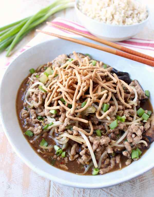 This easy Chinese Pork Chop Suey recipe combines pork, veggies & a delicious Asian sauce, served over white rice, topped with crispy chow mein noodles!