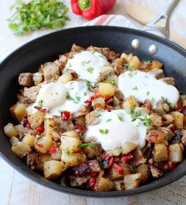 Leftover Bacon Wrapped Meatloaf is transformed into one seriously delicious one pot breakfast in this Meatloaf Hash Recipe with potatoes, onions & eggs!