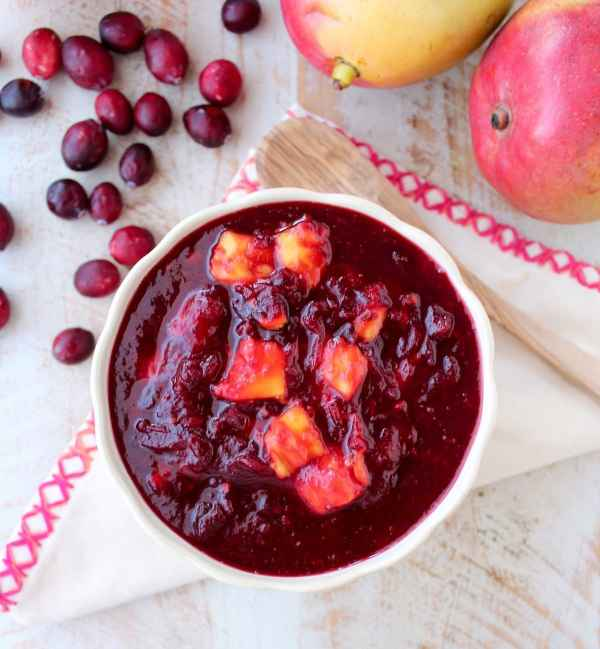 Chipotle peppers & fresh mango add smokey, sweet & tropical flavors to a traditional cranberry sauce, delicious as a ham glaze or perfect served with turkey!