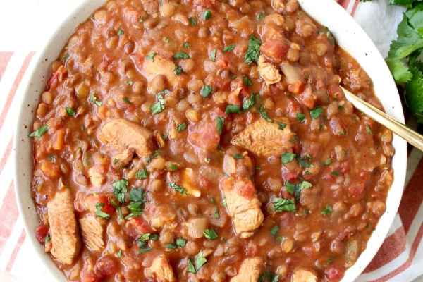 Chicken tikka masala and lentils are cooked together in an Instant Pot for an easy, gluten free weeknight meal made in under an hour!