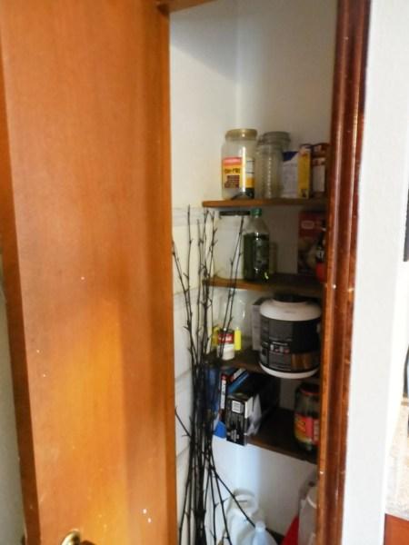 small tiny unorganized pantry