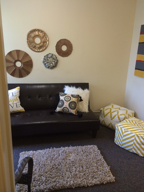 I love these floor poufs!! Jessica spray painted ceiling medallions and placed them on the wall!