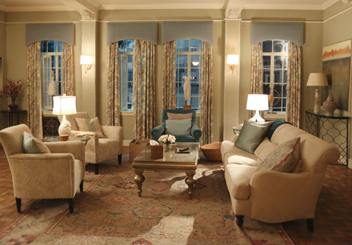 Olivia Pope's apartment is classic and traditional, neutral with pops of blue.