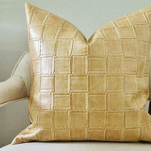 tan faux leather pillow