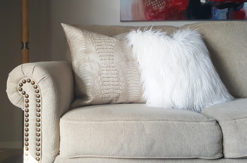 taupe faux leather pillow and white faux fur pillow