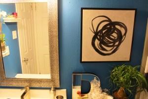 small blue apartment bathroom