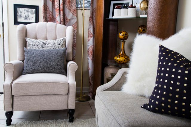 neutral living room | cream recliner | gold studs pillow | leather bookcase | neutral with pop of orange | britt smith photography