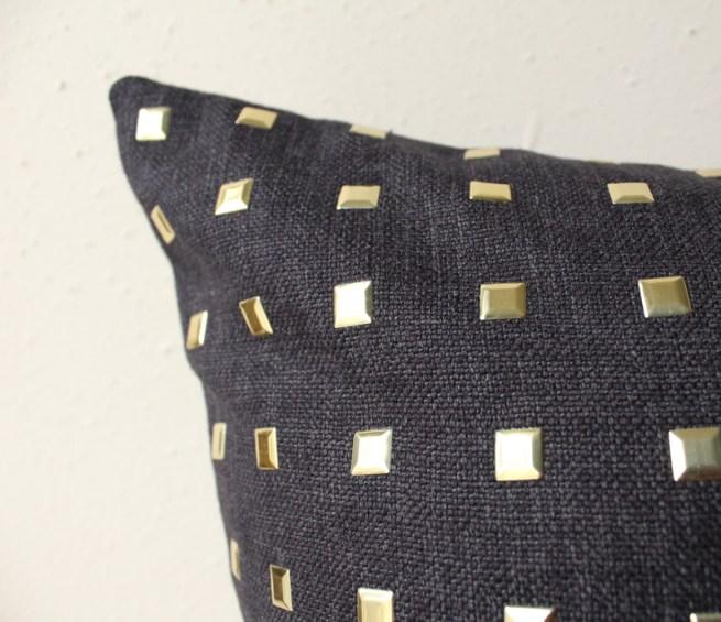 black gold studded pillow