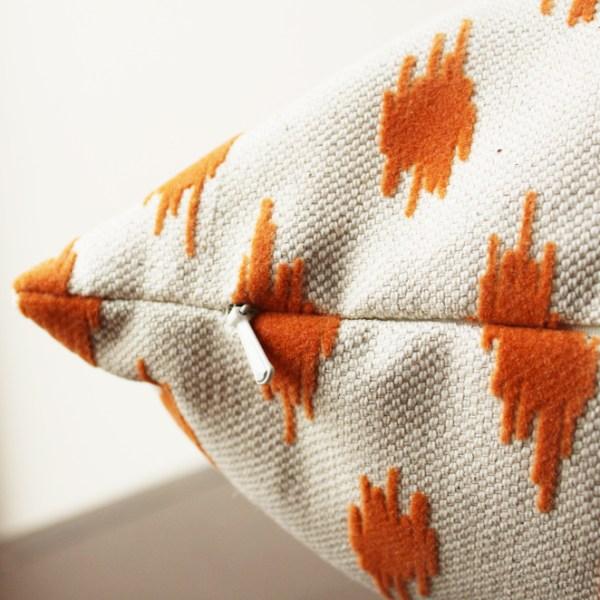 cream orange velvet pillow   orange velvet spots   eclectic decor   orange living room   orange bedroom