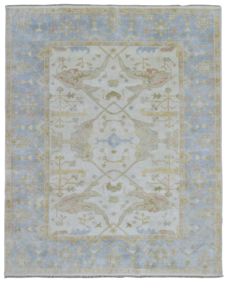 traditional room | transitional living room with traditional rug | glam living room | neutral transitional living room | blue neutral living room | soft blue living room | oushak oriental rug