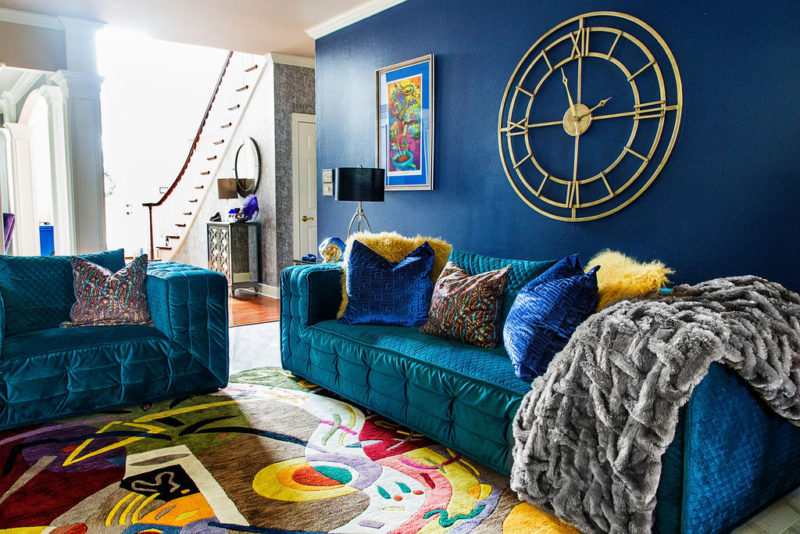 blue walls in colorful living room