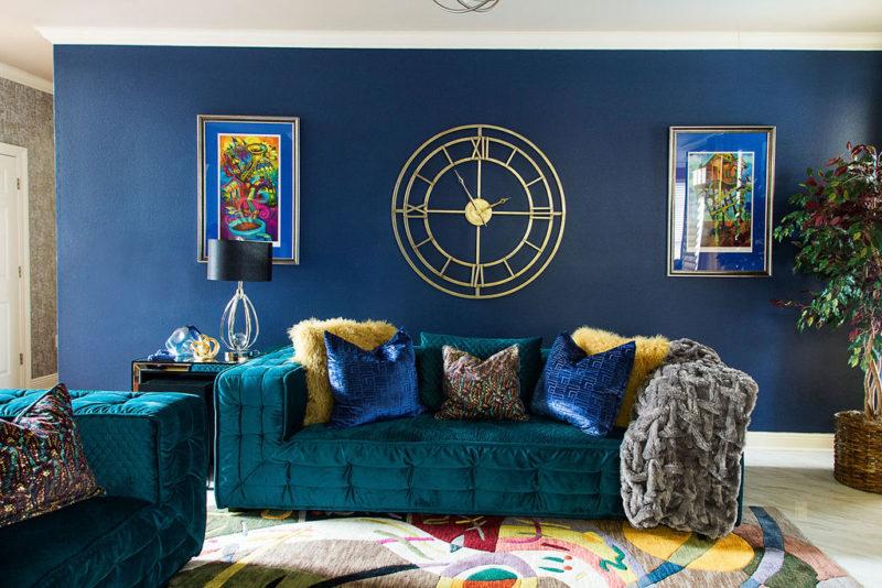 blue walls and green sofa
