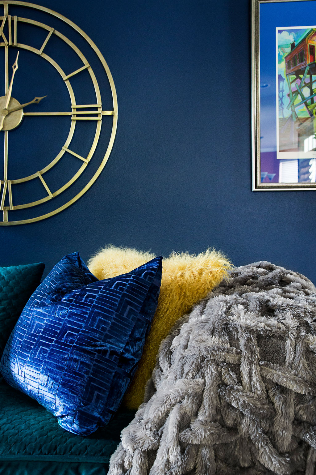 blue walls with colorful pillows