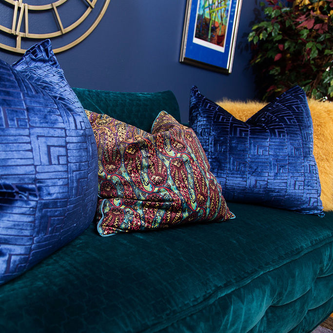 blue walls and blue pillows on green sofa