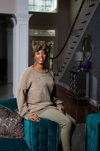 Whitney Jones of Whitney J Decor in bold, blue and green living room