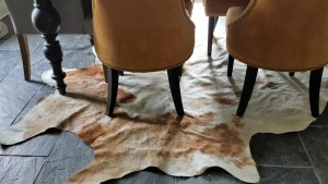 cowhide under dining room table