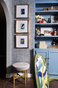 glam wallpaper and blue built in in dining room