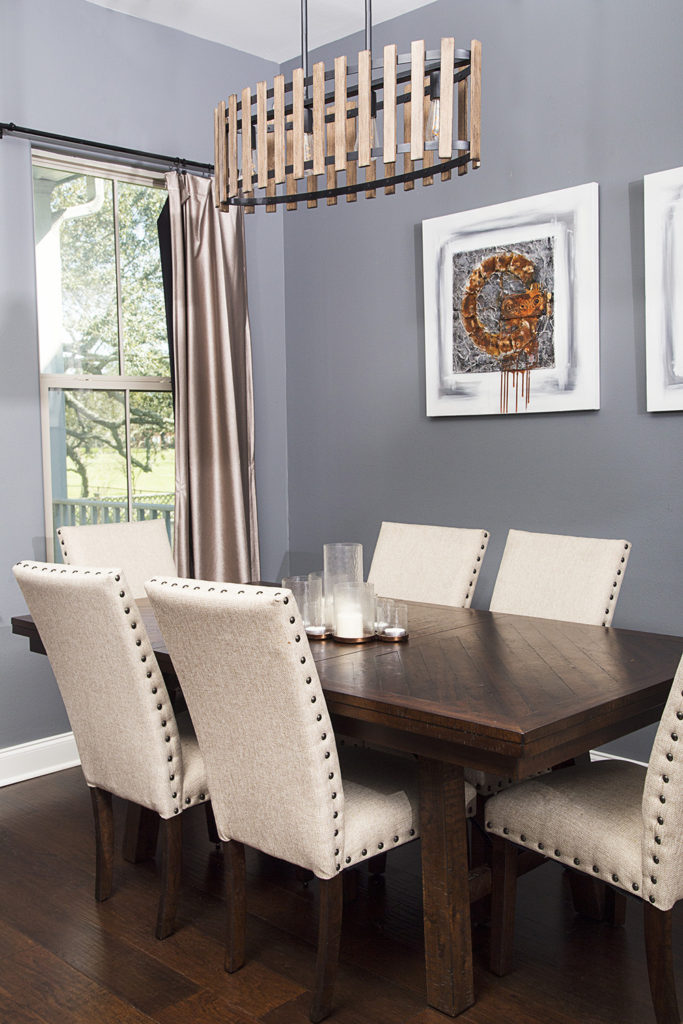 neutral dining room with orange accents