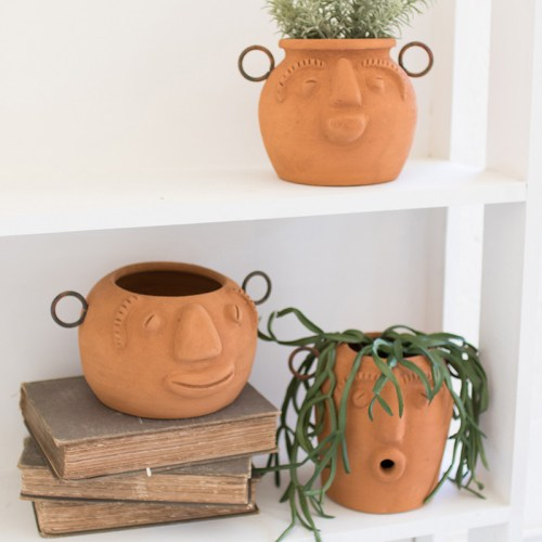 funky clay face planters