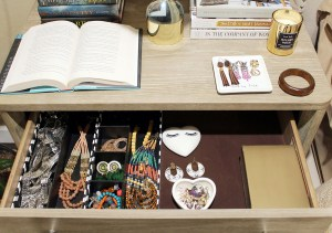 how to style a nightstand, organizing a bedroom, the inside of a nightstand drawer