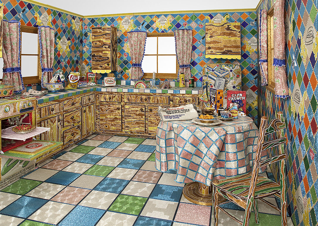 An installation of artwork representing a kitchen.